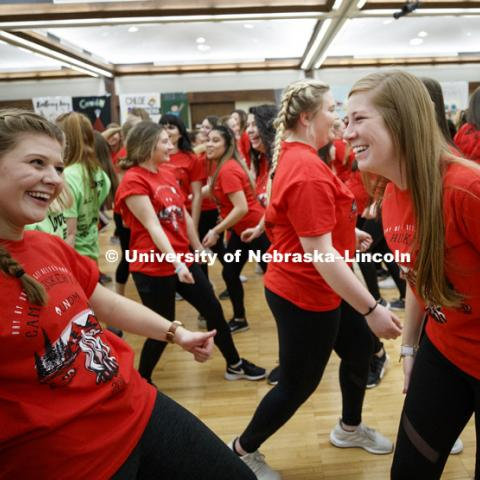 Phi Mu's Morgan Wirth-Murry and Ashlyn Salts are among 1274 Nebraska students dancing in the Huskerthon Dance Marathon for Omaha's Children's Hospital. The marathon takes over the second floor of the Nebraska Union. February 17, 2019. Photo by Craig