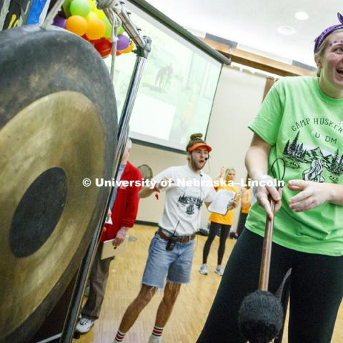 Kendall Kelly, Chi Omega, reacts after sounding the gong. She raised an extra $100 after the marathon began to get to bang the gong. 1274 Nebraska students signed up to be part of the Huskerthon Dance Marathon for Children's Hospital in Omaha. February 17