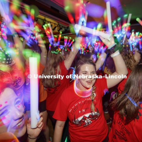 Phi Mu sorority members are surrounded by light wands and glow sticks on the Union Ballroom Saturday night. Phi Mu raised the most money of any group. 1274 Nebraska students signed up to be part of the Huskerthon Dance Marathon for Children's Hospital in