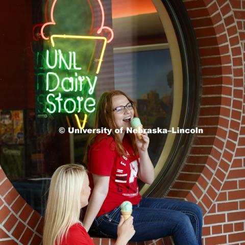 Students hang out in front the Dairy Store and enjoy a scoop of ice cream. CASNR photo shoot on East Campus. May 29, 2018. Photo by Craig Chandler / University Communication.