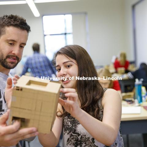 Chris Antonopoulos and Karolayn Chavez Loor discuss the structural openings and angles on Loor's model. Students work on concept models in DSGN 111 - Design Making. June 4, 2018. Photo by Craig Chandler / University Communication.