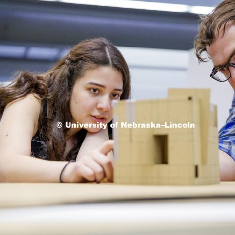 Karolayn Chavez Loor discusses the structural openings and angles on Loor's model with instructor Nate Bicak. Students work on concept models in DSGN 111 - Design Making. June 4, 2018. Photo by Craig Chandler / University Communication.