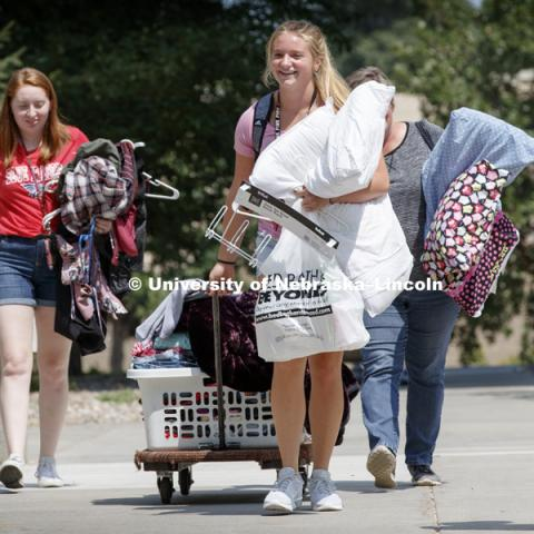 Samantha Simoneau from Burrton, Kansas, moves into Smith Hall Sunday afternoon. Housing move in for sorority rush week. August 12, 2018. Photo by Craig Chandler / University Communication.