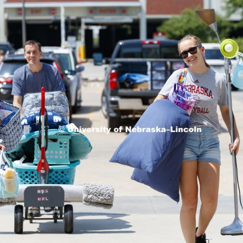 New freshman Emily Zimmerman, left, and her sister, Olivia, carry Emily's stuff toward Smith Hall. Housing move in for sorority rush week. August 12, 2018. Photo by Craig Chandler / University Communication.