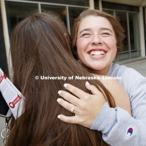 Kate Schroder of Crete gives her roommate, Hannah Cass of Lincoln, a hug after they met up at move in. Housing move in for sorority rush week. August 12, 2018. Photo by Craig Chandler / University Communication.