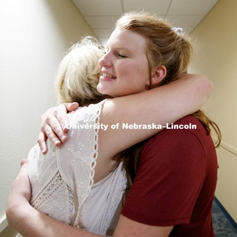 Grace Partridge of Rapid City, South Dakota, gives her mom, Katrina, a hug after moving into University Suites. Housing move in for sorority rush week. August 12, 2018. Photo by Craig Chandler / University Communication.