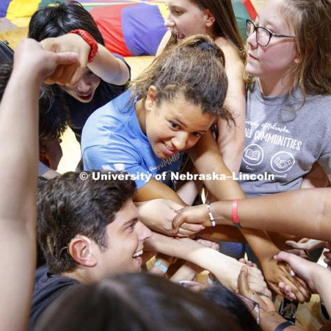 Students in the Global Experiences Learning Community try to untangle themselves without letting go of each other's hands during the Welcome Event in the rec center. August 17, 2018. Photo by Craig Chandler / University Communication.
