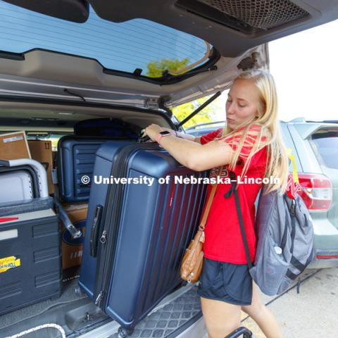 Sofia Heggem, of Lago Vista, Texas, unloads as she moves into her room Thursday morning. Residence Hall move-in. August 16, 2018. Photo by Craig Chandler / University Communication.