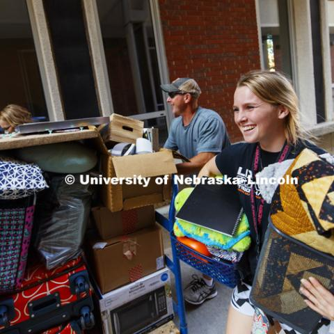 Makenzie Johnson moves into her room with the help of her parents, Ryan and Jennifer. Residence Hall move-in. August 16, 2018. Photo by Craig Chandler / University Communication.