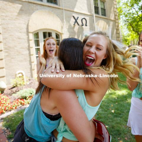 Hugs for a new sister at Chi Omega. Bid Day for Greek Sororities. August 18, 2018. Photo by Craig Chandler / University Communication.