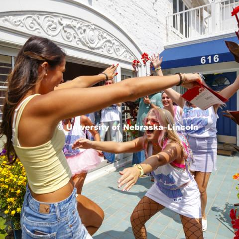 Kappa Kappa Gamma members welcome a new sister. Bid Day for Greek Sororities. August 18, 2018. Photo by Craig Chandler / University Communication.