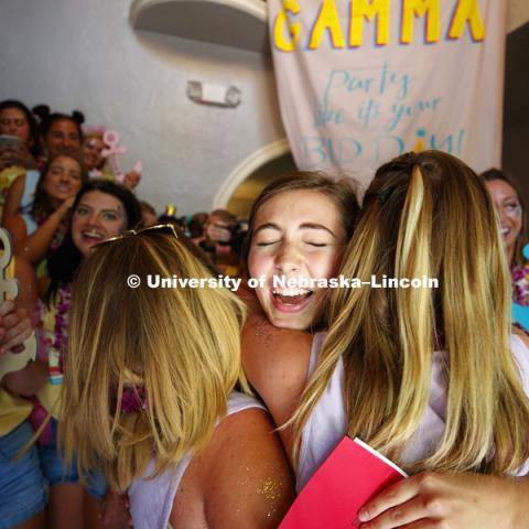 A new sorority sister is mobbed inside the Delta Gamma sorority. Bid Day for Greek Sororities. August 18, 2018. Photo by Craig Chandler / University Communication.