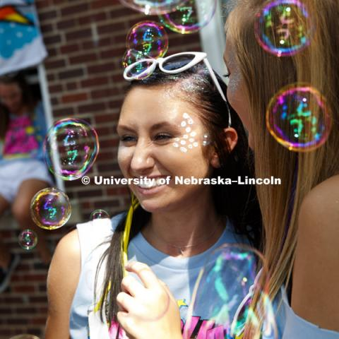 Alpha Chi Omege members pose for a photo as bubbles float through the air. Bid Day for Greek Sororities.  August 18, 2018. Photo by Craig Chandler / University Communication