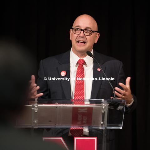 Michael Boehm talks to faculty and staff before the big reveal to the students. In Our Grit, Our Glory brand reveal party on east campus at the Nebraska Union. August 31, 2018. Photo by Greg Nathan, University Communication.