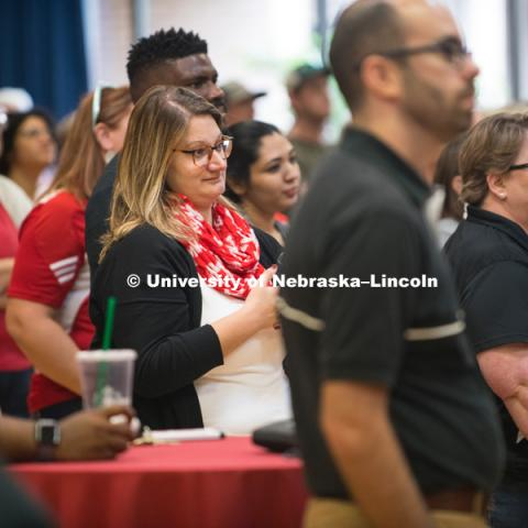 Faculty and staff learn about the new brand before the big reveal to the students. In Our Grit, Our Glory brand reveal party on east campus at the Nebraska Union. August 31, 2018. Photo by Greg Nathan, University Communication.