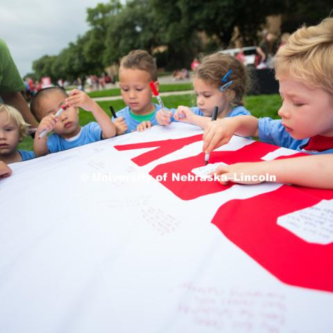 Everyone was asked to sign on a banner what girt and glory meant for them. In Our Grit, Our Glory brand reveal party on east campus at the Nebraska Union. August 31, 2018. Photo by Greg Nathan, University Communication.