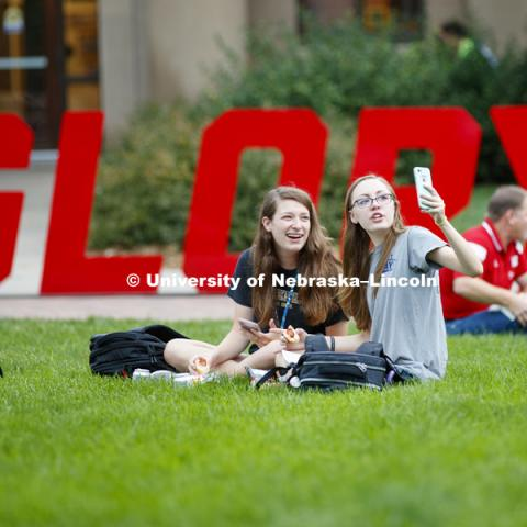 Miranda Mueller, left, and Miranda Hornung take a selfie while enjoying their lunches. In Our Grit, Our Glory brand reveal party on east campus at the Nebraska Union. August 31, 2018. Photo by Craig Chandler / University Communication.