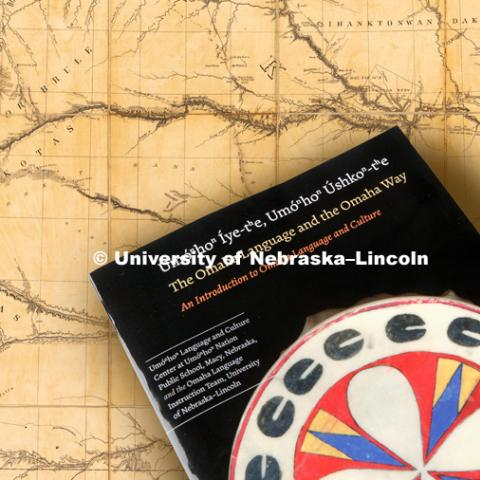 A group of university students and staff worked with members of Omaha Nation to produce a textbook of the Omaha language. Omaha Tribal Language book. Composited with a Library of Congress 1850s map of the northern Great Plains including Nebraska, Kansas and the Dakotas. September 10, 2018. Photo by Craig Chandler / University Communication.