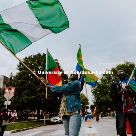 International students from African countries with the Nigerian flags flying, march in the 2018 Homecoming Parade. September 28, 2018. Photo by Justin Mohling / University Communication.