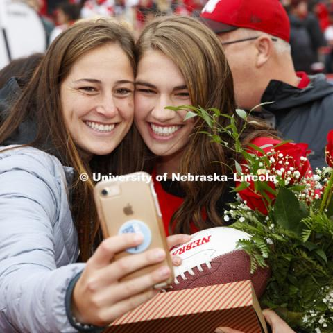 Queen Monica Rogers takes a selfie with friends after being crowned Homecoming Queen. Seniors Gage Hoegermeyer of Herman and Monica Rogers of Omaha were crowned king and queen at the University of Nebraska–Lincoln's homecoming celebration. Hoegermeyer and Rogers, elected in an online vote of the student body on Sept. 27, were crowned on the field at Memorial Stadium during halftime of the Sept. 29 Nebraska-Purdue football game. September 29, 2018. Photo by Craig Chandler / University Communication.