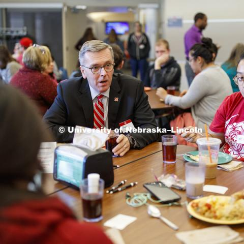 Chancellor Ronnie Green talks with other first generation college students including Annie Romero, a sophomore from Madison, NE. First Gen Nebraska: Share A Meal event at Selleck Dining Hall. October 23, 2018. Photo by Craig Chandler / University Communication.