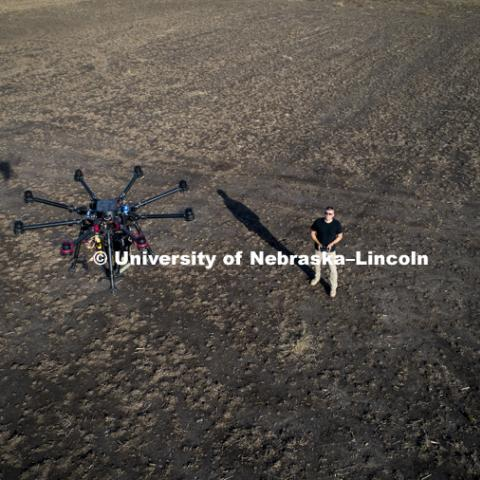 Nebraska's Adam Plowcha, graduate student in computer science and Navy veteran, pilots a large UACV drone that is being developed to drill holes and place sensors in soil. The vehicle has multiple applications, from agriculture to national defense. October 26, 2018. Photo by Craig Chandler / University Communication.