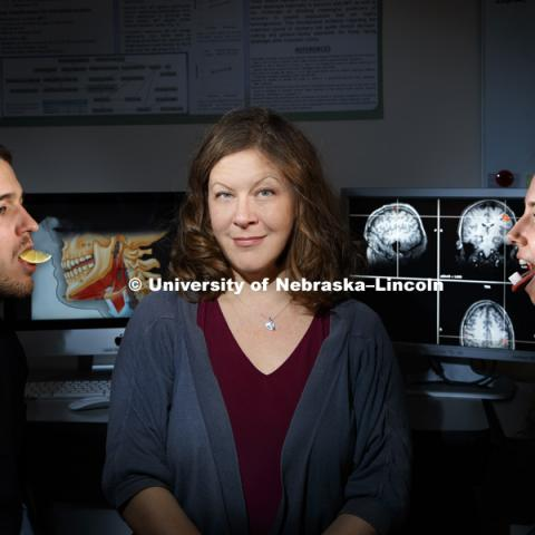 Angela Dietsch, Assistant Professor Special Education and Communication Disorders, is using the sense of taste and MRI scans to help stroke victims recover their swallowing mechanics, PhD student Ross Westemeyer of North Liberty, IA, models sour while grad student Megan Asselin of Lincoln models sweet. November 12, 2018. Photo by Craig Chandler / University Communication.
