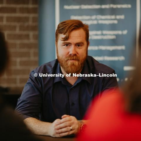 "Dr. Tyler White (Political Science), has developed a ""war game"" for about 40 UNL students focused on risk mitigation and conflict escalation in a world where both cyber and nuclear threats are a growing issue. November 16, 2018. Photo by Justin Mohling, University Communication."