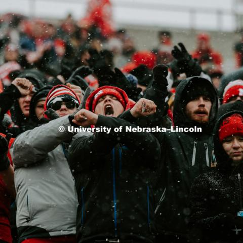 Fans bundled up for the cold and snowy Nebraska vs. Michigan State University football game in Memorial Stadium. November 17, 2018. Photo by Justin Mohling / University Communication.