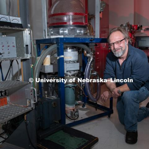 Joe Lutes worked on a two-stage vacuum pump in a lab in Jorgensen Hall. On Dec. 14, Joe will be celebrating his 53rd birthday, and a much bigger milestone — he'll be finishing a college degree 35 years in the making. December 11th, 2018. Photo by Gregory Nathan /University Communication.