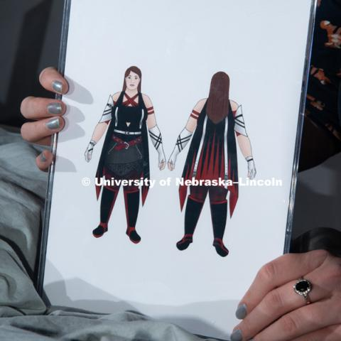 "Grad student, Stephanie Pitcher is pictured with avatars from her thesis project, inspired by games such as ""Assassin's Creed"" and ""Final Fantasy."" She designed clothing for her avatars to show ""real"" body types with practical outfits. December 13, 2018. Photo by Greg Nathan, University Communication."