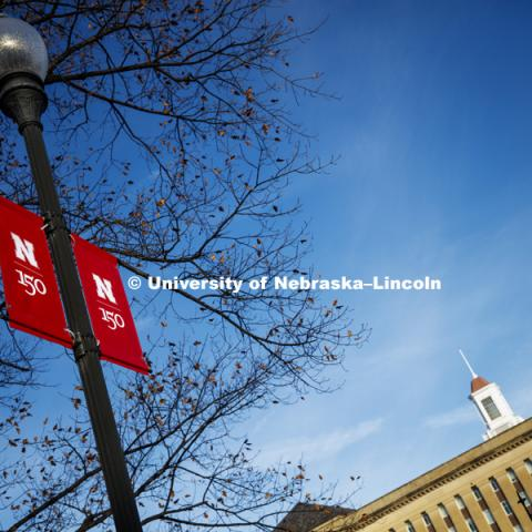 New banners to celebrate the university's 150th anniversary are being hung on campus. December 18, 2018. Photo by Craig Chandler / University Communication.