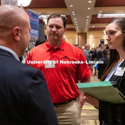 Jill Schindler talks with recruiters from Farm Bureau at the STEM Career Fair (Science, Technology, Engineering, and Math) in Embassy Suites. Sponsored by Career Services. February 12, 2019. Photo by Gregory Nathan / University Communication.