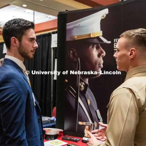 Taylor Gannon talks with a recruiter from The US Marines at the STEM Career Fair (Science, Technology, Engineering, and Math) in Embassy Suites. Sponsored by Career Services. February 12, 2019. Photo by Gregory Nathan / University Communication.