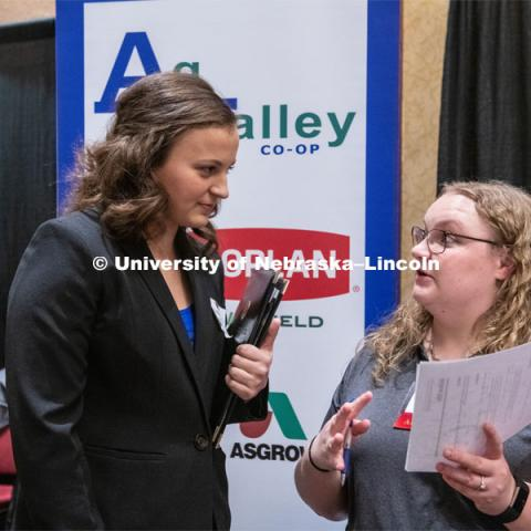 Madison Mills talks with a recruiter from Ag Valley Co-op at the STEM Career Fair (Science, Technology, Engineering, and Math) in Embassy Suites. Sponsored by Career Services. February 12th, 2019. Photo by Gregory Nathan / University Communication.