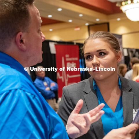 Angelica Wellman speaks with a recruiter at the STEM Career Fair (Science, Technology, Engineering, and Math) in Embassy Suites. Sponsored by Career Services. February 12, 2019. Photo by Gregory Nathan / University Communication.