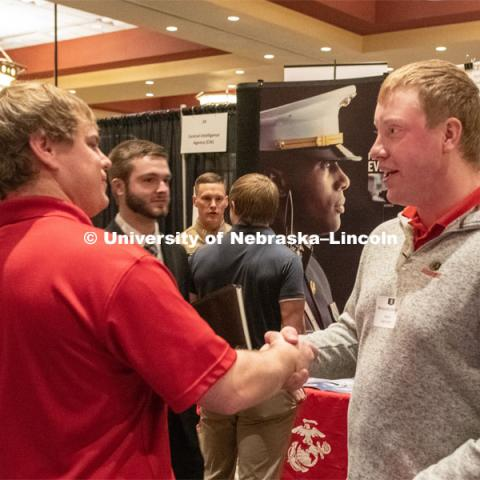 Benjamin Barlean speaks with a recruiter from Ag Valley C0-OP at the STEM Career Fair (Science, Technology, Engineering, and Math) in Embassy Suites. Sponsored by Career Services. February 12, 2019. Photo by Gregory Nathan / University Communication.