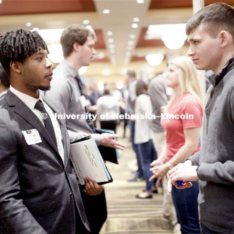 Jay Clark, senior in computer science, talks with a recruiter during day two of the Career Fair at Embassey Suites with emphasis on Science, Technology, Engineering and Mathematics. February 13, 2019.  Photo by Craig Chandler/University Communication.