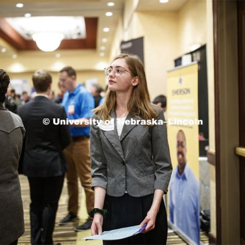 Carly Thody, a junior in environmental studies, look over the possibilities during day two of the Career Fair at Embassey Suites with emphasis on Science, Technology, Engineering and Mathematics. February 13, 2019.  Photo by Craig Chandler/University Communication.