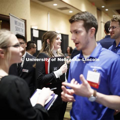 Allison Hauger, senior in Biological Systems Engineering, talks with a recruiter during day two of the Career Fair at Embassey Suites with emphasis on Science, Technology, Engineering and Mathematics. February 13, 2019.  Photo by Craig Chandler/University Communication.