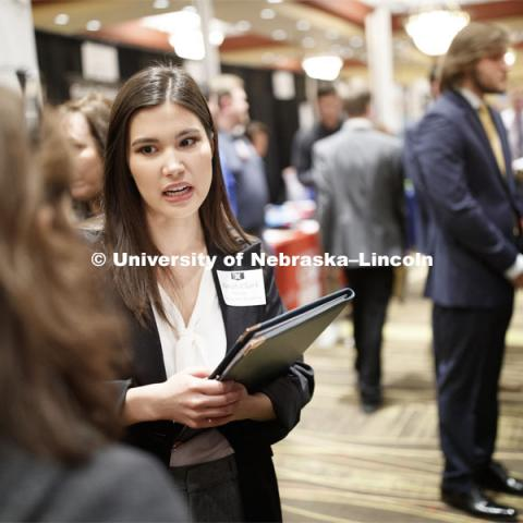 Sarah Clark, senior in computer science, talks with a recruiter during day two of the Career Fair at Embassey Suites with emphasis on Science, Technology, Engineering and Mathematics. February 13, 2019.  Photo by Craig Chandler/University Communication.