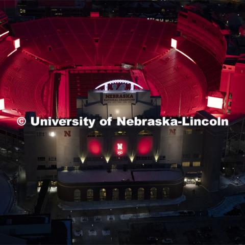 Memorial Stadium is a big red anchor to the colorful city campus Thursday night. Glow Big Red bathes the campuses with red lights as part of N150's Charter Week celebration. February 14, 2019. Photo by Craig Chandler / University Communication.