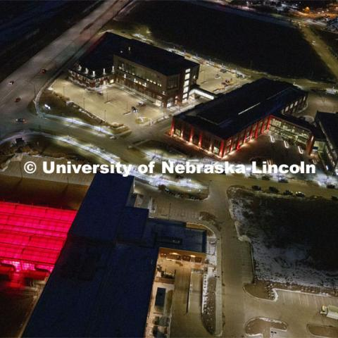 Aerial of Nebraska Innovation Campus lit up red for Glow Big Red. Glow Big Red bathes the campuses with red lights as part of N150's Charter Week celebration. February 14, 2019. Photo by Craig Chandler / University Communication.
