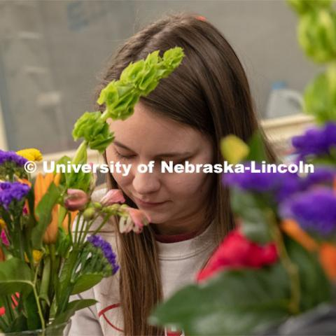 A student completes a spray during Stacy Adams floral design class. Hort 261- Floral Design 1, in Plant Sciences Hall. Students create floral arrangements. February 26, 2019. Photo by Gregory Nathan / University Communication.