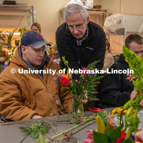 Stacy Adams (center), associate professor of practice in agronomy and horticulture, helps two students create their arrangements in Floral Design class Hort 261- Floral Design 1, in Plant Sciences Hall. Students create floral arrangements. February 26, 2019. Photo by Gregory Nathan / University Communication.