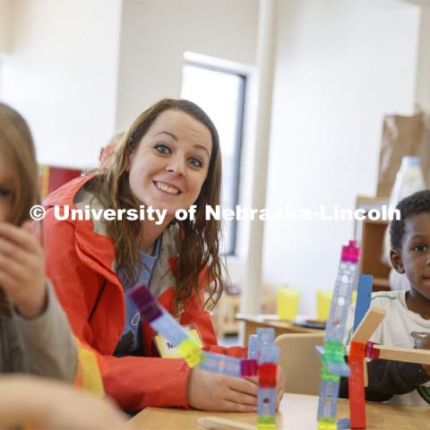 Monica Meyer, senior in Inclusive Child Youth and Family Studies, works with children at the Malone Center. Ruth Staples Child Development Lab student teachers and children work with children at the Malone Center. February 28, 2019. Photo by Craig Chandler / University Communication.