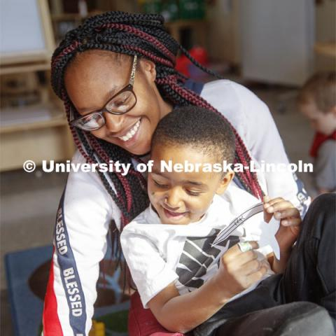 DaVon Jackson, an instructor at the Malone Center, works with a group of children Thursday morning. Ruth Staples Child Development Lab student teachers and children work with children at the Malone Center. February 28, 2019. Photo by Craig Chandler / University Communication
