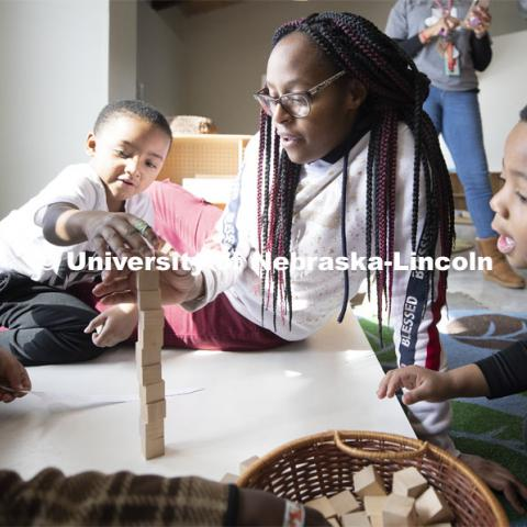 DaVon Jackson, an instructor at the Malone Center, works with a group of children Thursday morning. Ruth Staples Child Development Lab student teachers and children work with children at the Malone Center. Febrary 28, 2019. Photo by Craig Chandler / University Communication