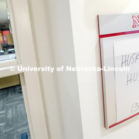 "Temporary signs mark the Husker Hub's location in the former CBA Career Services Office. Husker Hub is a new ""one-stop"" office offering integrated services from the offices of Scholarships and Financial Aid, University Registrar, Bursar and Student Accounts. Husker Hub is where students go to handle the business of being a Husker. March 8, 2019. Photo by Craig Chandler / University Communication."