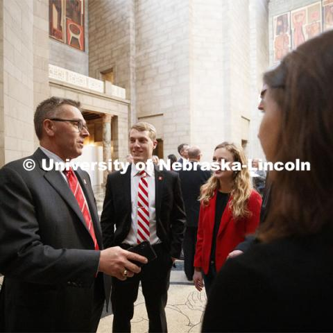 Chancellor Ronnie Green speaks with ASUN President Hunter Traynor and other UNL students in the capitol rotunda during NU Advocacy Day at the Nebraska Legislature. March 27, 2019. Photo by Craig Chandler / University Communication.